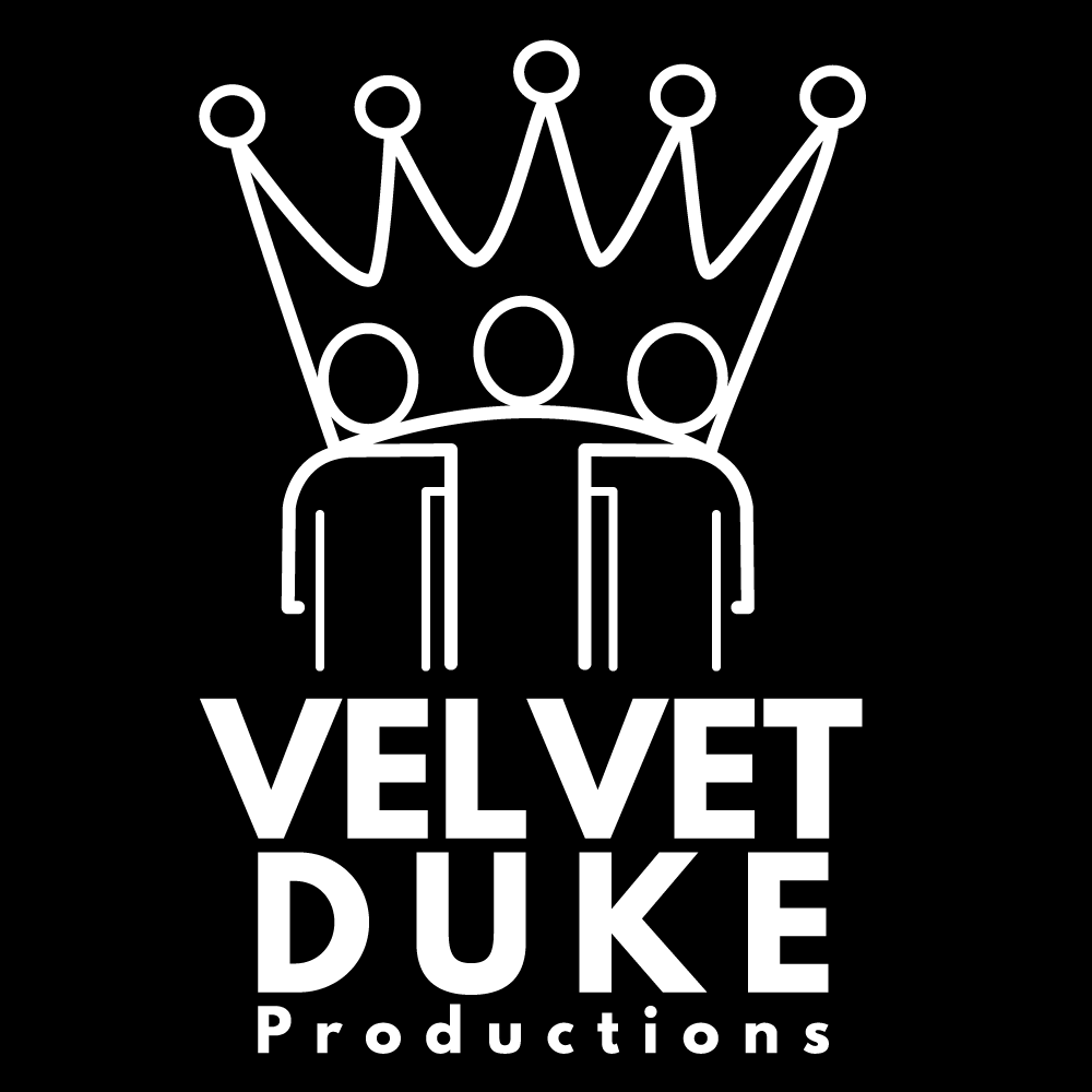 """Image Description:  The Velvet Duke Productions logo and watermark is a white line drawing of a crown resting on the shoulders of three performers, incorporating their heads as bigger jewels. Below the logo are the words Velvet Duke Productions. All centered on a black background. The crown and performers represent the """"I is We"""" nature of community, and creative energy within the world"""